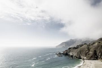 Fog at rocky ocean coast
