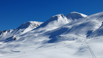 Snow covered mountains and ski slopes, ski area Stoos