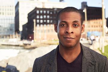 Black man smiling at waterfront