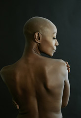 Nude African American woman looking over her shoulder