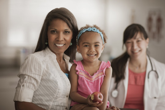 Mother and daughter in doctor's office
