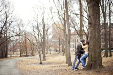 Couple kissing in urban park