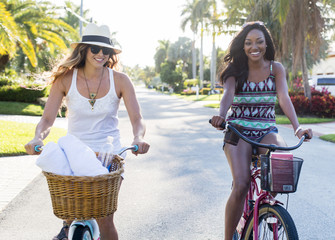Smiling women riding bicycles