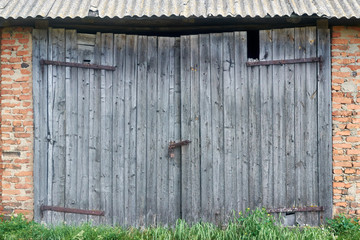 old decaying wooden barn gate