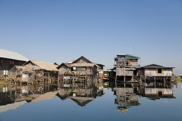 Wooden houses over water