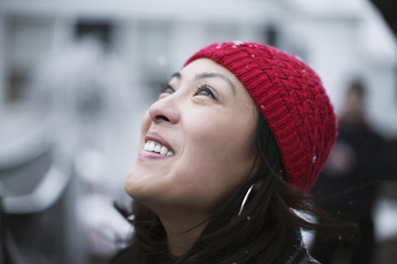 Mixed race woman watching it snow