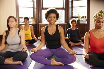 Women doing yoga in the yoga class