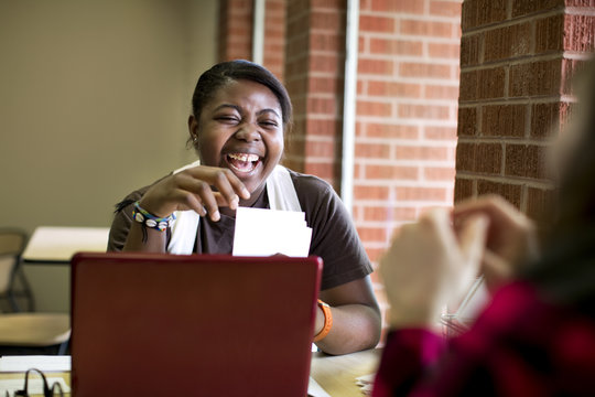 Laughing African American woman sitting in cafe