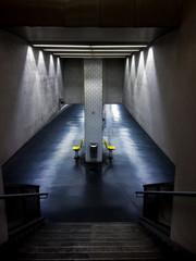 Empty chairs in urban underground tunnel