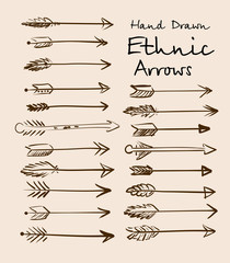 Set of ethnic arrows hand-drawn on a beige background for your design. Vector