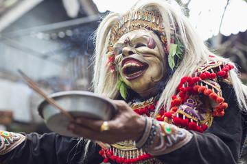 Balinese performer wearing mask and costume, Mas, Bali, Indonesia