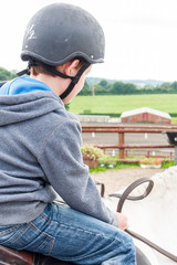 Boy horse riding