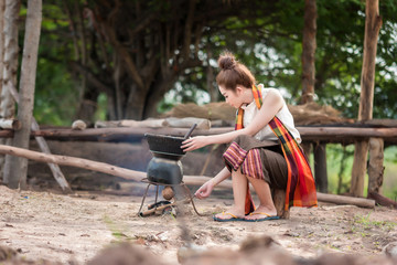 Rural woman cooking in the morning.