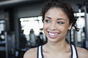 Smiling mixed race woman in health club