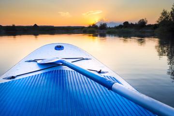 Standup-Paddling at a small lake, sundown