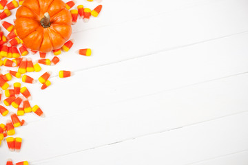 Autumn: Candy Corn And Pumpkin Background