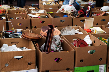 many cardboard boxes with used stuff for sale at the flea market