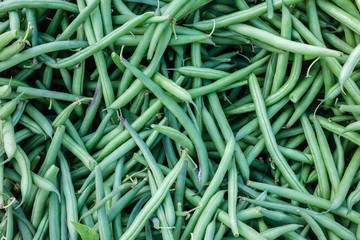 Closeup detail of organic green beans at an outdoor market in Seattle.
