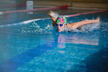 portrait of  girl sport butterfly swimming