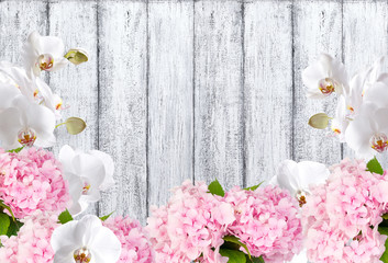 Hortensia with orchid on background of shabby wooden planks
