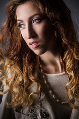 Fashion young woman portrait in studio
