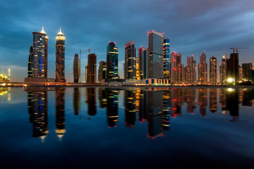 Fascinating reflection of tallest skyscrapers in Business Bay, Dubai, United Arab Emirates