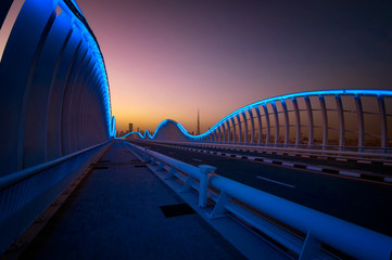 Amazing night VIP bridge during beautiful sunset. Private road to Meydan race course, Dubai, United Arab Emirates