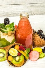 green and red smoothies in a jar with lime
