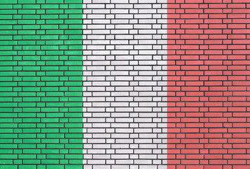 Italian flag painted on brick wall