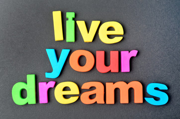 Live your dreams on black background