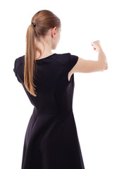 skinny woman funny fights waving his arms and legs. Isolated over white background. Blonde in a short black dress punches.