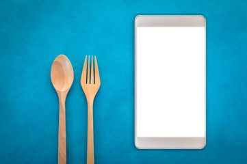 Wooden Spoon and fork with smartphone.jpg