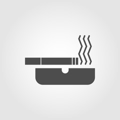 Cigarette in an ash tray with smoke icon symbol for apps and websites