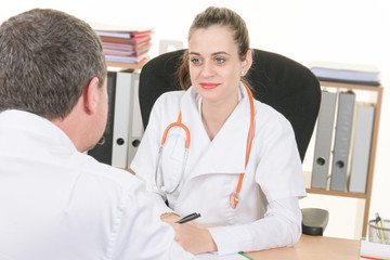 Confident female doctor discussing diagnosis with patient in off