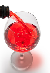 red wine pouring into wine