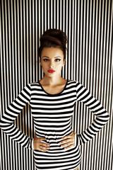fashion woman in striped dress in studio