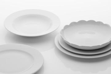 kitchen and restaurant utensils, plates, on a light background