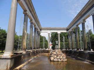 a big beautiful fountain with columns summer
