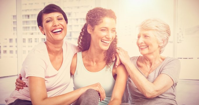 Cheerful fit women in yoga class