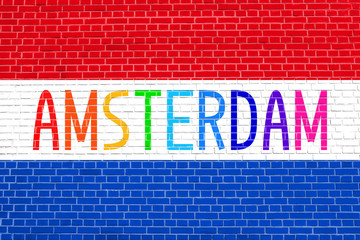 Netherlands flag and word Amsterdam on brick wall