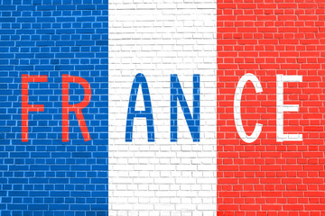 French flag and word France on brick wall
