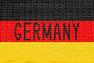 German flag and word Germany on brick wall
