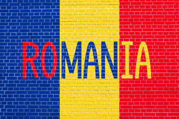 Romanian flag and word Romania on brick wall