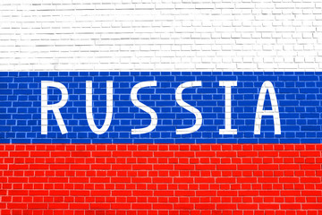 Russian flag and word Russia on brick wall