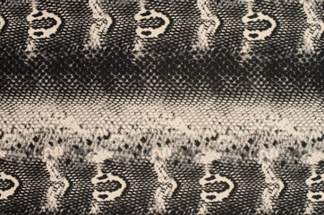 Snake skin pattern on fabric. Close up on black and brown snake skin print for background.