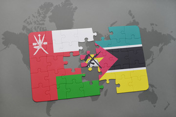 puzzle with the national flag of oman and mozambique on a world map background.