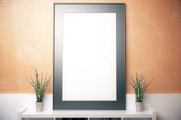 Blank frame on orange wall