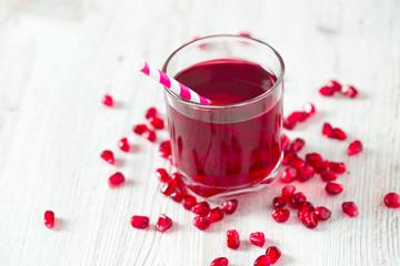 pomegranate juice on table