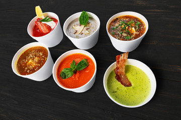 Variety of soups from different cuisines at black wood