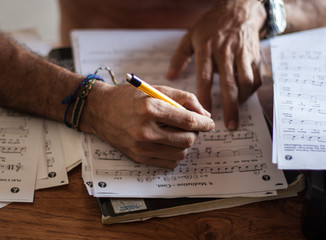 Man who is learning to read sheet music